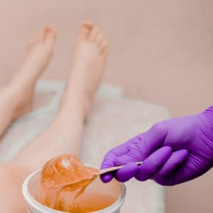Nitrile glove about to wax legs